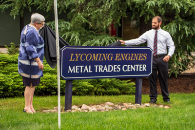 Gilmour and Bitterman unveil the new Lycoming Engines Metal Trades Center sign.
