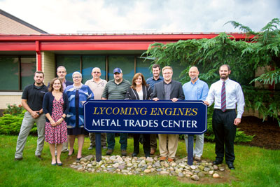 Representatives from Lycoming Engines and the Penn College community gathered to dedicate the Lycoming Engines Metal Trades Center sign on the front lawn of the facility.
